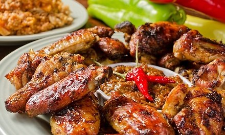 Up to 33% Off- Food and Drinks for Two or More At Fire Wings