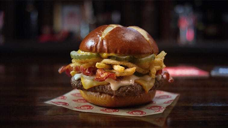Wendy's Brings Back Pretzel Buns for New Pretzel Bacon Pub Cheeseburger with Beer Cheese