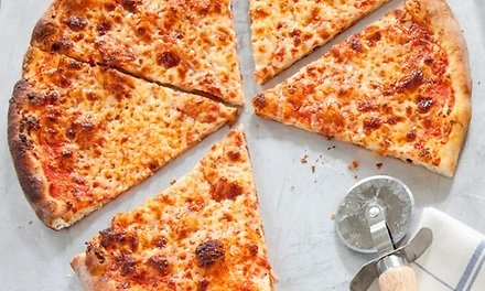Pizza or Spaghetti Meal Package At Puree's Pizza & Pasta (Up to 28% Off). Two Options Available.