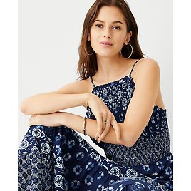 AT $50 Off Dresses, Skirts & Shoes